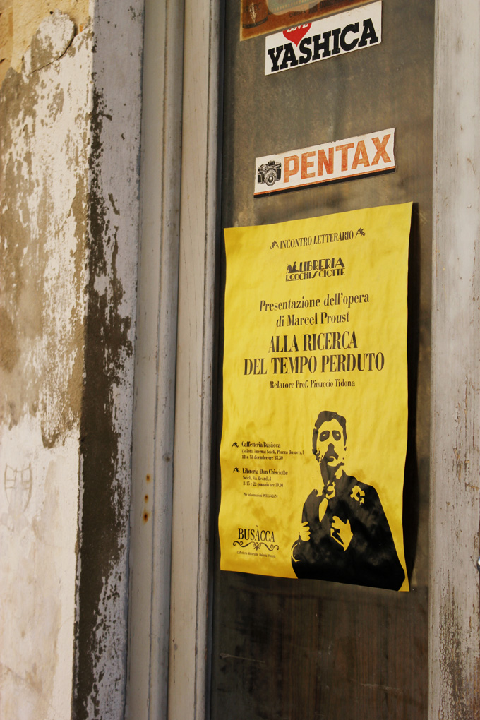 Literary event poster on a shop Scicli Sicily