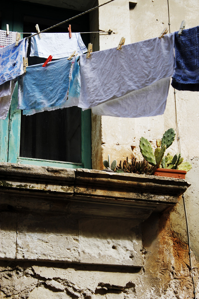 Washing line from a window in Scicli Sicily